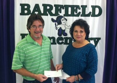 bill taylor giving a check to barfield elementary