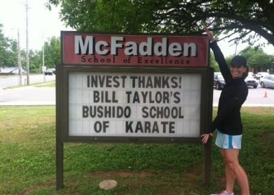 McFadden elementary school sign - sign says: invest thanks! Bill Taylor's Bushido School of Karate