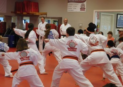 karate class in action in dojo